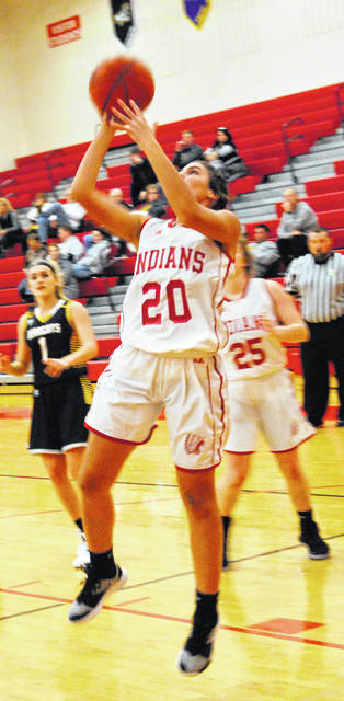 Karleigh Hopkins going up for a layup for the Lady Indians in photo shown above