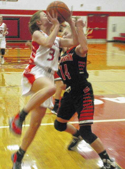 Lady Lions' Ella Newkirk going up layup against Lady Wildcats' Kara Ward.
