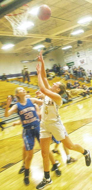 Lady Tigers' Bri Weller going up for a layup during the Clinton Massie game shown in photo above.