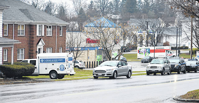 An Ohio Bureau of Criminal Investigation vehicle and Hillsboro Police Department vehicles are pictured Saturday near the seen of death in the 400 block of North High Street.