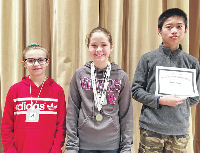 The Greenfield Middle School Geography Bee took place on the morning of Wednesday, Dec. 4 in the McClain Auditorium. The first place finisher was Olivia Stegbauer (center). The second place finisher was Dennis Huang (right) and third place was awarded to Tessa Anderson.