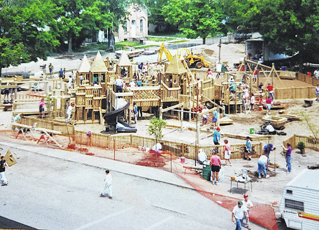 Taken from the Greenfield Elementary School, this picture shows community volunteers in May of 1993 constructing the Imagination Kingdom.