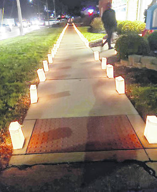 A street in Leesburg is lined with Luminaria candles during the 31st annual event last Sunday.