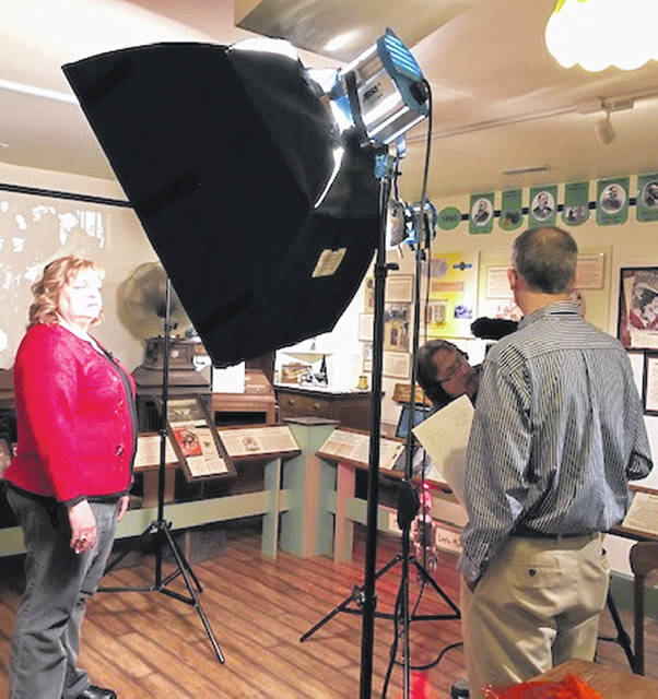 Curator Charlotte Pack is filmed by the crew of Sentimental Productions at the Music Makers Museum last week east of Hillsboro on U.S.Route 50.