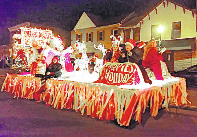 The Eagles' float is pictured Saturday evening during the 38th annual Greenfield Eagles Christmas Parade. This year's theme was Rockin' 'Round The Christmas Tree. After the parade children were able to visit with Santa and receive treats at the Paint Creek Joint EMS/Fire District on North Washington Street.