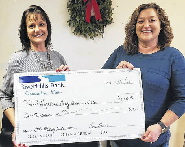 Shown from left, Kim Banks of RiverHills Bank presents a check for $1,000 to Tammy Dennis, administrative director of the Highland County Homeless Shelter.