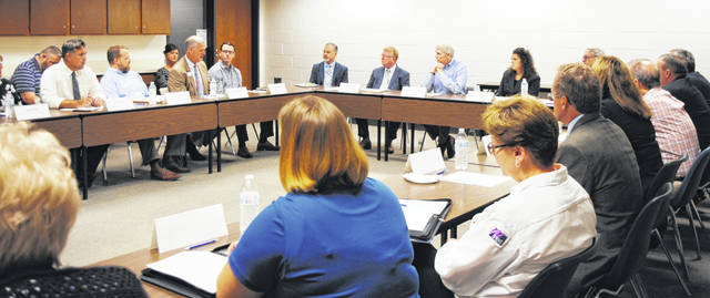 In a scene from an August 2019 visit at SSCC, Sen. Rob Portman meets with local community leaders and business owners to discuss the workforce and education.