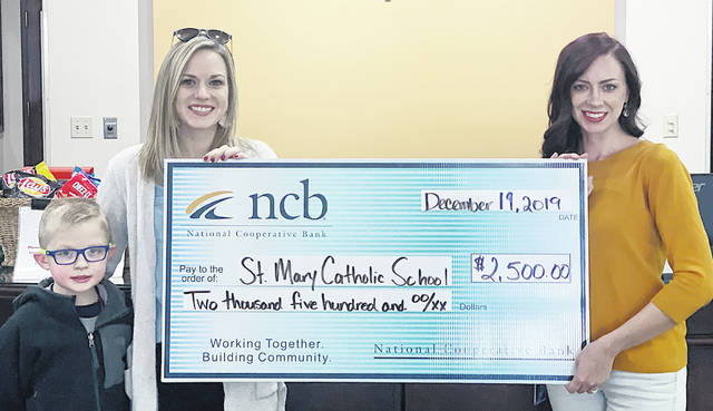 NCB awarded St. Mary Catholic School $2,500 for its scholarship program. Pictured are St. Mary Principal, Amanda Hunter, left, with student Christian, and NCB's Whitney Bradley.