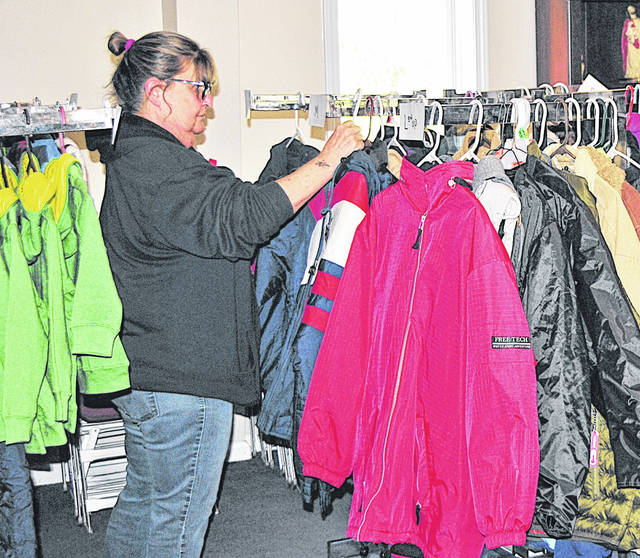 Hilda Hamilton sorts through coats for Storm's Christmas Blessing a year ago.