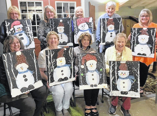 """Members of the Hillsboro Towne Club recently got together at New Vienna's Field of Dreams art studio for what member Patsy Holthouse called a """"Paint-n-Party"""" that was planned by fellow member Karyn Evans, under the guidance of studio owner Letty Allen. Holding their works of art called """"Nice Little Snowmen"""" are (front row, l-r) Marilyn Mathews, Patsy Holthouse, Caroline Siemers and Ann Lerch; (back row, l-r) Siobhan Smith, Karyn Evans, Vicki Smith, Carol Terrell and Karen Daniels. Club members also decorated a tree at Highland House Museum in Hillsboro, and Holthouse encouraged everyone to visit the museum gift shop to find handcrafted and unusual gifts created by local artists, books by local artists and more during the Christmas season."""