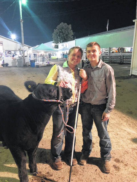 Hillsboro FFA member Mallory Parsons and seventh grade Ag student Carter Boyd prepare to enter the show ring.