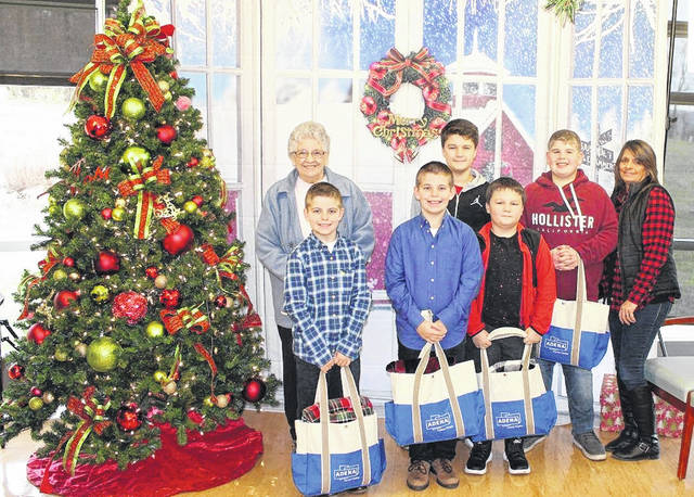 Colton McNeal, his family and friends pose next to a Christmas tree in December 2018. Pictured are (back row, l-r) Norma VanDyke, Carson Bell, Alex Perie and Cindy McNeal; (front row, l-r) Landen McNeal, Colton McNeal and Jordan Bell.