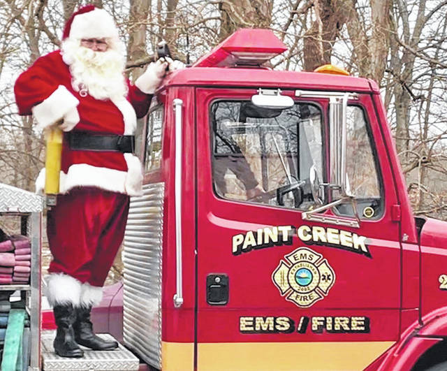 "In a scene from a previous ""Christmas at the Lake: An Afternoon with Santa"" event, Santa rides a Paint Creek Joint EMS/Fire District truck."