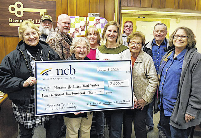 NCB's Mary Alice Hartley presents a check for $2,500 to the Because He Lives Food Pantry in Lynchburg.