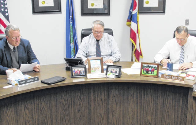 Highland County commissioners, from left, Gary Abernathy, Jeff Duncan and Terry Britton worked through a long list of resolutions during their final meeting of the year held Tuesday afternoon.