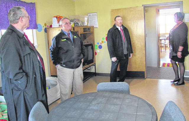 From left, commissioners Gary Abernathy, Jeff Duncan and Terry Britton take a guided tour of the Highland County Family Advocacy Center with director Melissa Wheaton on Wednesday morning.