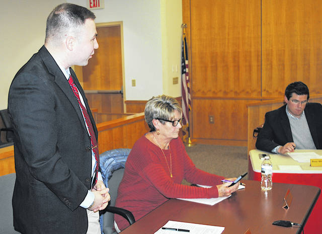 New Hillsboro Auditor Alex Butler, standing, speaks at Monday's city council meeting held at the Highland County Justice Center. Also pictured are council members Mary Stanforth, center, and Dane Allard.