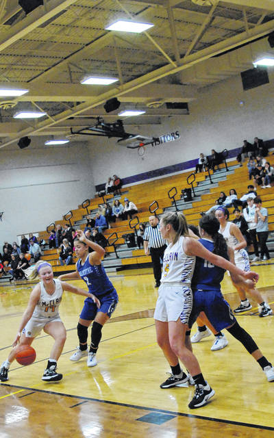 Jaelyn Pitzer of McClain driving past Chillicothe defenders as shown in this photo.