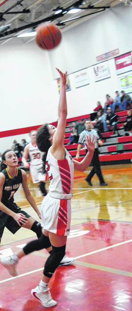Lady Lions' Peyton Magee going up for a layup during the loss to the North Adams Lady Devils.