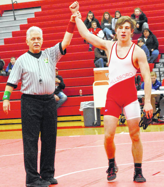Issac Lewis getting his hand raised after his victory in the 132 weight class during the dual match against Chillicothe.