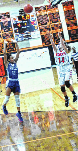 Ripleys' Azyiah Williams attempts to block Lady Wildcats' Kara Ward as she scores a three point jump shot, shown in this photo