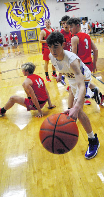 Braden Wright extending out for a loose ball shown in this photo