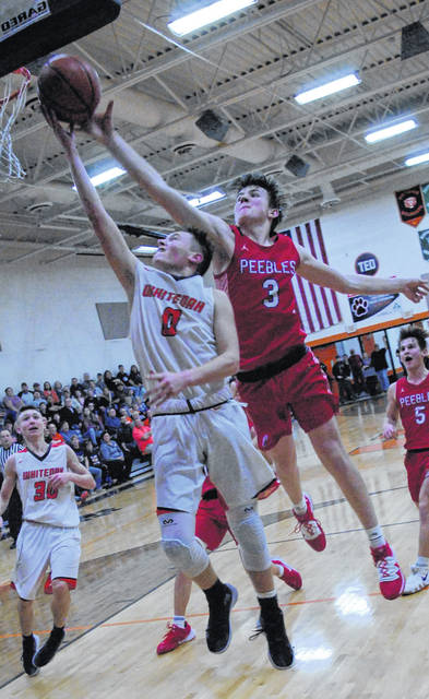 Whiteoak loses to Southern Hills Athletic Conference rival, the Peebles Indians 65-59, Wildcats' Bradley Ashbaugh being blocked going up for a layup by Peebles Dawson Mills.