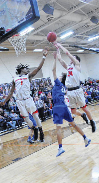 Wildcats' Nick Bailey and Josh Hughes going up for the ball with a Ripley defender between the two, shown in this photo.