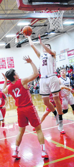 Conner Priest going up for a layup during the 80-72 loss to the Peebles Indians shown in this photo.