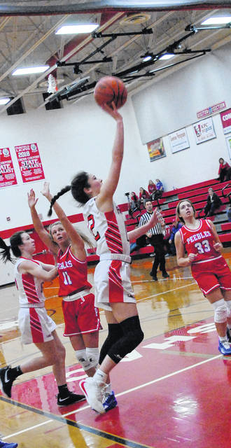 Lady Lions' Peyton Magee going up for a layup shown in this photo.