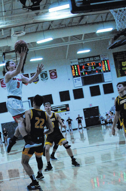 Wildcats' Carson Emery going up and over for a layup shown in this photo