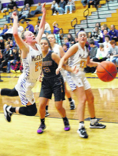 Tigers' Kyla Burchett leaping to save the ball from going out of bound in 51-44 loss to Unioto.