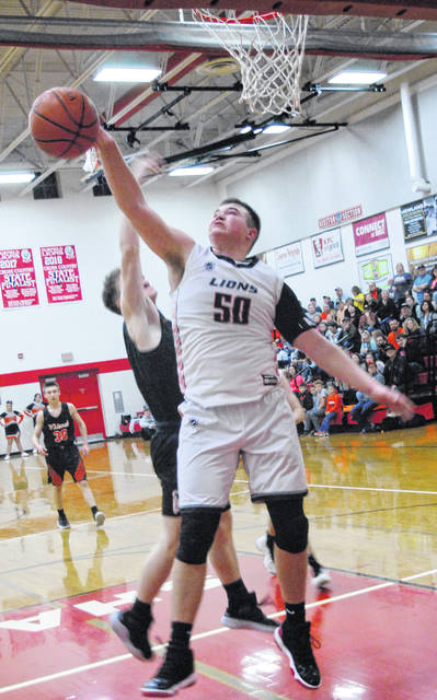 Lions' Jon Bentley block shot attempt by Whiteoak during the 51-44 loss to the Wildcats,