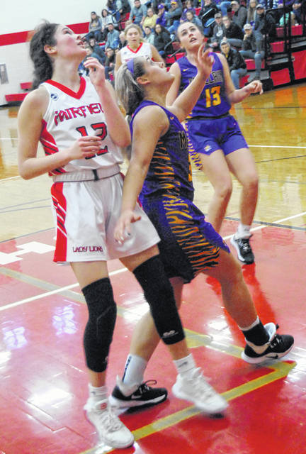 Tigers' Emma Stegbauer boxing out Peyton Magee during the McClain victory over Fairfield.