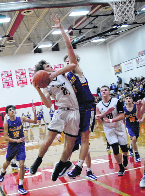 Lions' leading scorer Wyatt Willey going up for a layup during the 67-57 win over McClain.