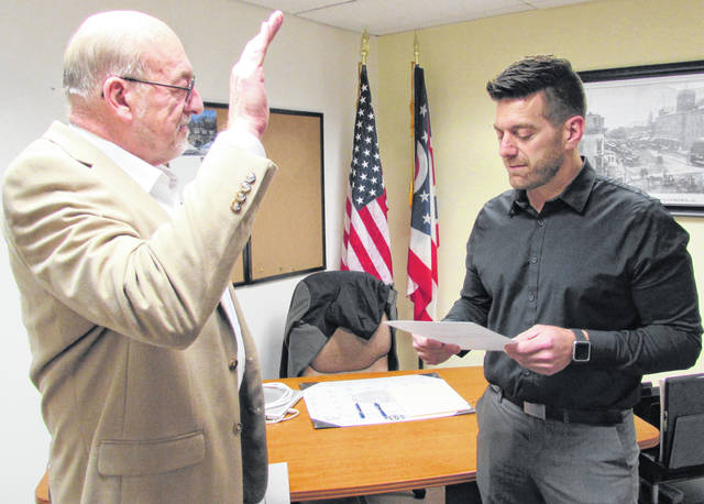 In his first official acts as the new mayor of Hillsboro, Justin Harsha administered the oath of office to a new Hillsboro patrol officer and to two members of Hillsboro City Council in ceremonies held Thursday morning. In this photo, Thomas Eichinger, left, is shown being sworn in by Harsha. Eichinger has been serving in the position since April when he was appointed after Lee Koogler resigned in March. Eichinger defeated Jim Cameron in November's general election.