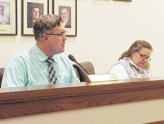 Greenfield City Manager Todd Wilkin, left, delivers his report to council members Tuesday. Also Pictured is council clerk Roberta Karnes.