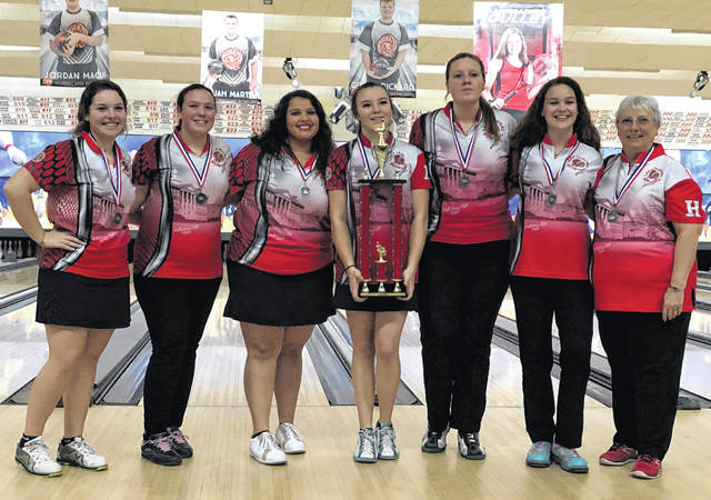 The Hillsboro Lady Indians holding their first place trophy at the Muskingum University Invitational at Royal Z Lanes in Wilmington, shown in this photo.