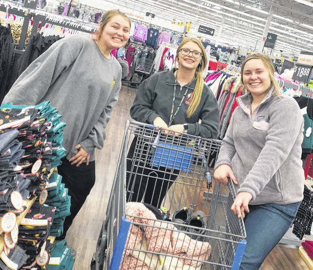 Pictured, from left, are Christine Paige, Kelcie Thornburgh and Mallory Parsons shopping for the Hillsboro FFA Adopt-A-Family.