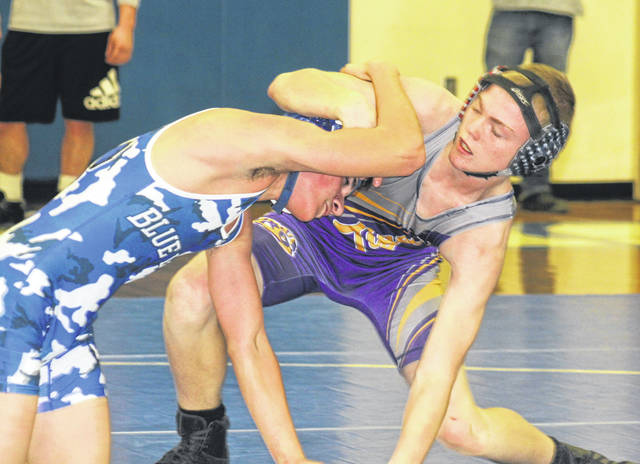 McClain's Josh Breakfield wrestling Washington's James Caldwell at 126 pounds Thursday, Jan. 9 at Washington High School.
