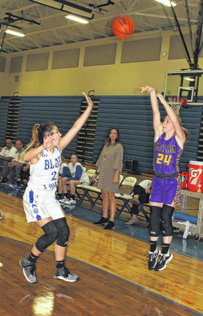 The picture is Kyla Burchett (the game's leading scorer with 24 points) shooting over Washington's Aaralyne Estep.