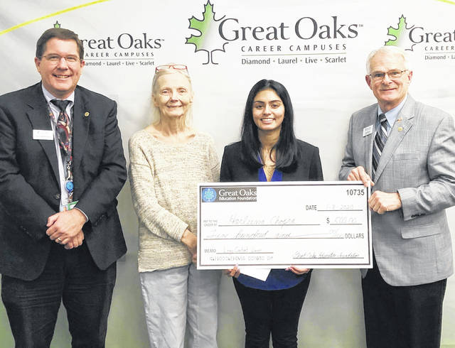 From left, Great Oaks Dean of Satellite Programs Ted Kirkpatrick, Harleena Chopra, Great Oaks board member Debbie Delp of Mason and board member Jim Perdue of Reading.