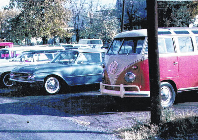 """<style type=""""text/css""""></style> The 1960 Volkswagen Bus mentioned in a recent """"Looking Back"""" article, in the used car lot of Hillsboro Auto Co. circa 1964 from a photo provided by Nina Couser of Hillsboro. Couser said while enjoying """"Looking Back"""" in last Saturday's edition of The Times-Gazette, something caught her eye: the mention of an Hillsboro Auto Co. ad for a Volkswagen Bus Type 2. Couser said her husband Jim was a salesman for the dealership at the time, and Jim's cousin, David """"D.L."""" Couser, had traded in the old 1960 van for a new Ford Galaxie 500. In fact, she said her husband recalled making two sales that day: Jim also sold a new Galaxie to D.L.'s father, who was with D.L. that day. All three vehicles have since been relegated to the scrap yard, but Couser said D.L. is still """"alive and kicking"""" at 90 years young, and lives in a senior living facility near Troy, Ohio."""