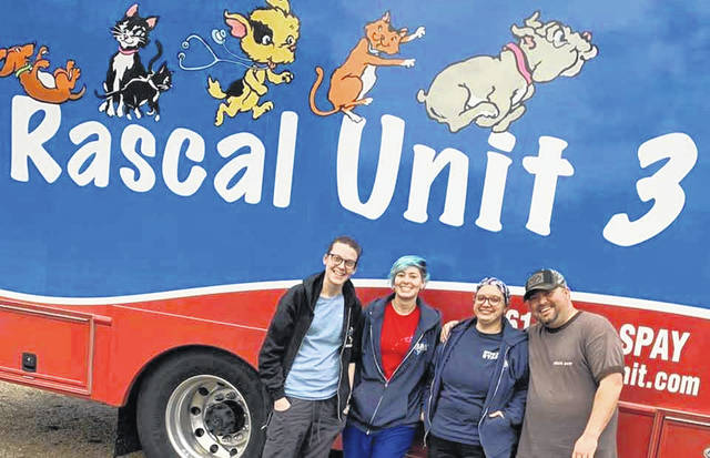 The Rascal Unit team from the Highland County Humane Society's Jan. 15 spay and neuter clinic stand in front of the mobile veterinary hospital.