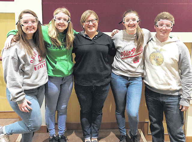 Pictured are Katie Craig, Jaiden Hughes, Alora Brown, and Joe Helterbrand with Sarah Weisner (center) at Central State University.