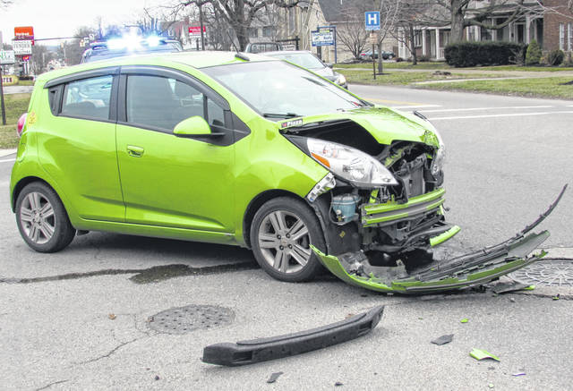 A delivery driver for 24 Deli in Hillsboro suffered minor injuries in a two-car crash Wednesday at North High and West Beech streets.