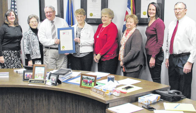 The Highland County commissioners issued a proclamation Wednesday honoring the local Waw-wil-a-way Chapter of the Daughters of the American Revolution on their 125th anniversary. Shown, from left, are Elissa Zornes, Judy Hornsby, commissioner Jeff Duncan, Jane Stowers, Janet Florence, Vicki Knauff, commissioners clerk Mary Remsing and commissioner Terry Britton.