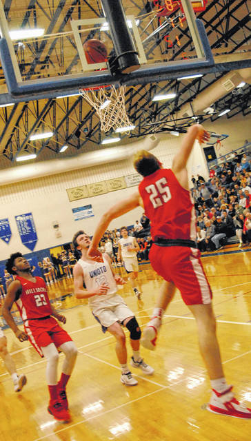 Hunter Pence of Hillsboro going up for a layup as Jakwon Clark is watching for the putback if needed.