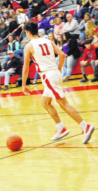 Ryan Scott taking the ball down the floor for the Hillsboro Indians during the Highland County rival matchup.