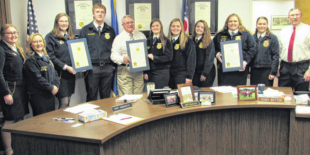 The Highland County commissioners issued a proclamation in honor of National FFA Week during their regular Wednesday meeting. Members from four Highland County FFA chapters were on hand to receive a proclamation for each school. Shown, from left, are Breanna Flint and Alexis Tompkins from Fairfield, Kara Williams and Kurt Hamilton from Lynchburg-Clay, commission president Jeff Duncan, Alora Brown, Breanna Cooper and Jaiden Hughes from Hillsboro, Cora Gillespie and Cylee Bratton from Whiteoak, and commissioner Terry Britton.
